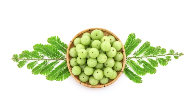 Indian gooseberry fruits and juice isolated on white background.top view,flat lay.