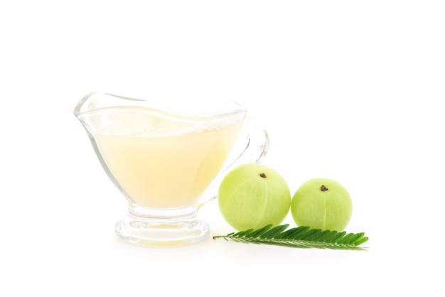 Indian gooseberry fruits and juice isolated on white background.