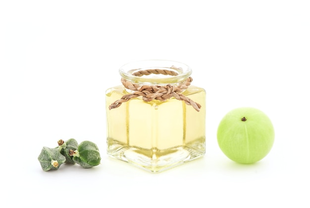 Indian gooseberry fruits,seeds and oil isolated on white background.