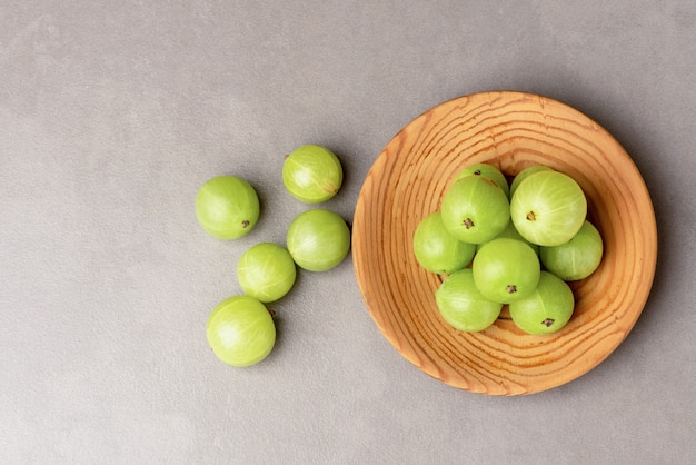Indian gooseberry or phyllanthus emblica fruits on ceramic background.top view,flat lay.