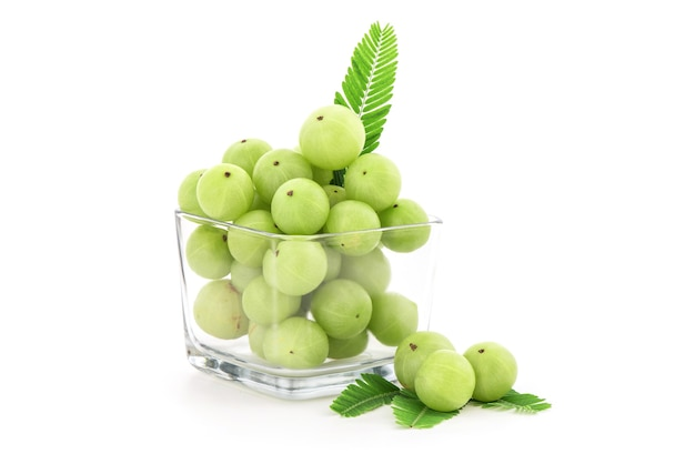 Indian gooseberry or phyllanthus emblica fruits isolated on white background.