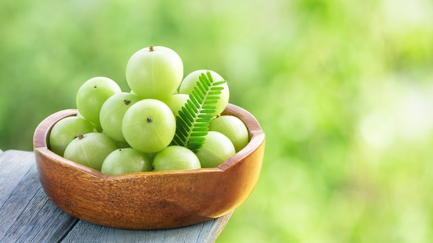 Indian gooseberry or phyllanthus emblica fruits on nature background.