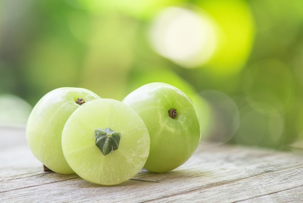 Indian gooseberry or phyllanthus emblica fruits in nature.