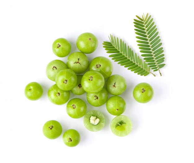Indian gooseberry with leaf on white background. top view