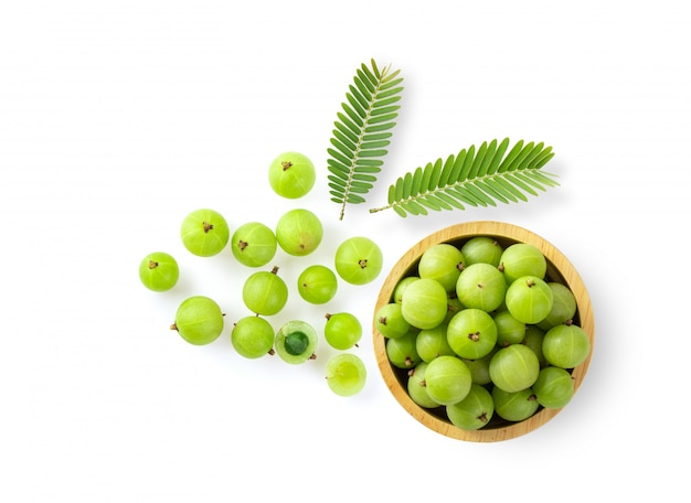 Indian gooseberry in wood bowl