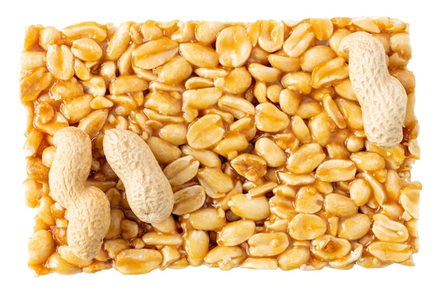 Indian groundnut chikki bar isolated on white with peanut in shell