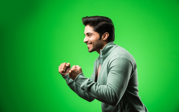 Indian handsome man with success gesture, standing isolated