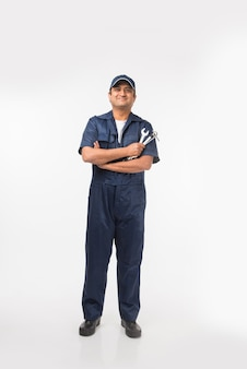 Indian happy auto mechanic in blue suit and cap