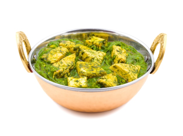 Indian healthy cuisine palak paneer on white background