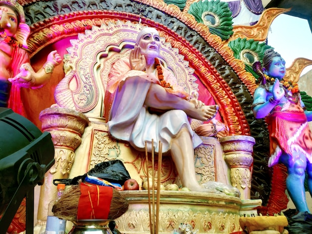 Indian hindu god shirdiwale sai baba blessing stone idol in hindu spiritual temple, regarded by his devotees as a saint.