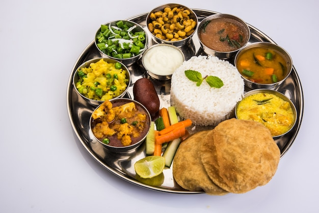 Indian or hindu veg thali also known as food platter is a complete lunch or dinner meal, closeup, selective focus