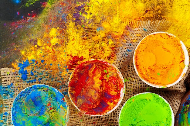 Indian holi festival colours in small  bowls on dark