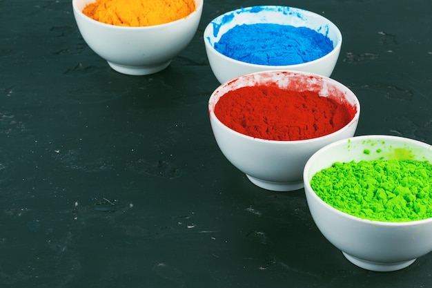 Indian holi festival colours in small  bowls