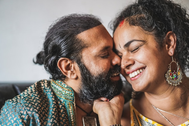 Indian husband and wife having tender moments - portrait of happy southern asian couple - love, ethnic and india's culture concept