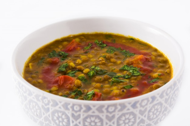 Indian lentil soup dal in a bowl isolated