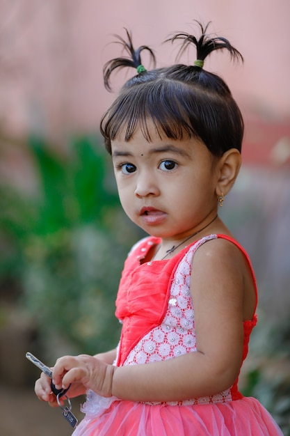 Cute indian baby girl playing in the park Photo