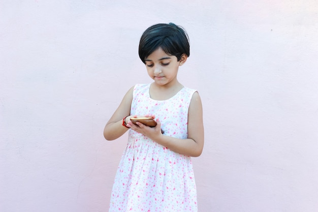 Indian little girl with mobile phone