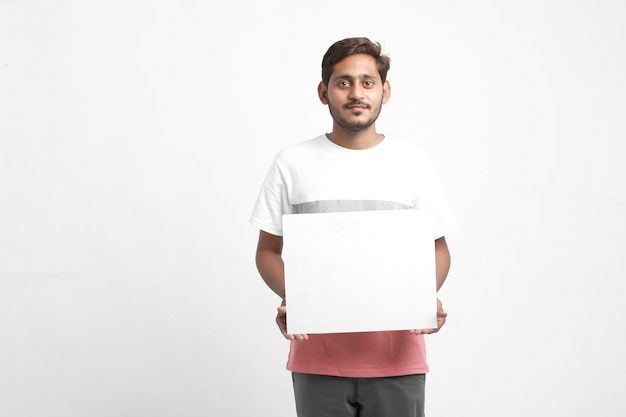 Indian male college student showing blank poster