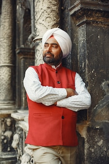 Indian man in a city. male in a traditional turban. hinduist in a summer city.