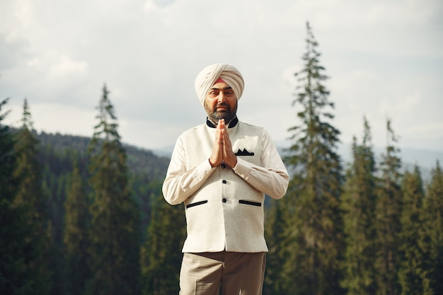 Indian man in a mountains. male in a traditional turban. hinduist.