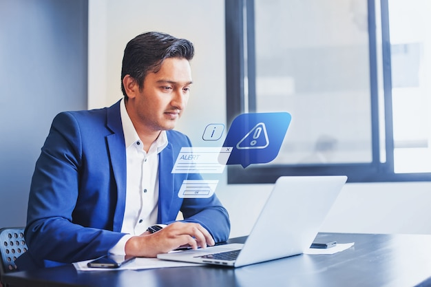 Indian man receiving alert notification in financial fraud protection software