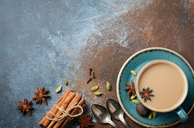 Indian masala chai tea. spiced tea with milk on dark rusty