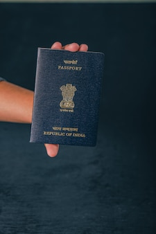 Indian passport in hand , showing passport
