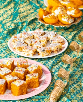 Indian popular sweet food sugar free dry fruits with mung dal chakki or chandrakala