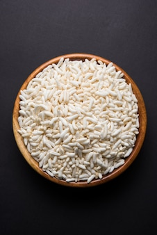 Indian puffed rice or murmure in gunny bag or cloth, isolated on white background