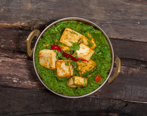 Indian punjabi cuisine palak paneer made up of spinach and cottage cheese decorative in kadhai