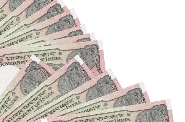 インドルピー紙幣は白い背景で隔離されて横たわっています