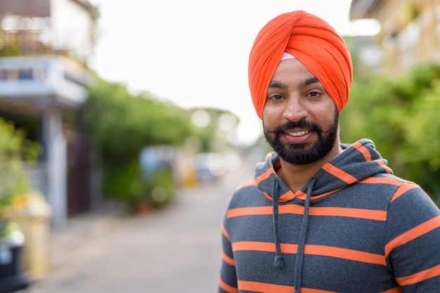 Indian sikh man wearing turban in the streets outdoors