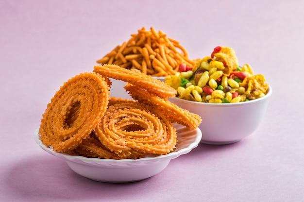 Indian snack : chakli, chakali or murukku and besan (gram flour) sev and chivada or chiwada . diwali food