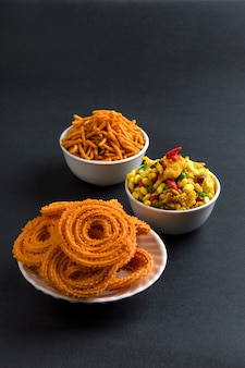 Indian snack : chakli, chakali or murukku and besan (gram flour) sev and chivada or chiwada. diwali food