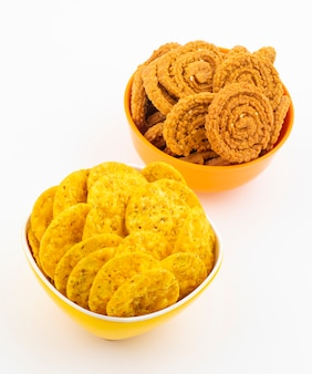 Indian snack masala khari papdi or chakli on white