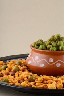 Indian snack : mixture and spiced fried green peas {chatpata matar}.