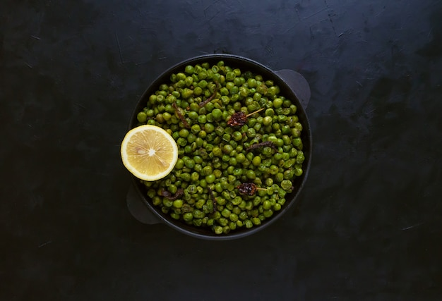 Indian spiced peas. traditional indian garnish of fried green peas with spices.