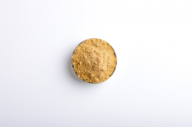 Indian spices coriander powder in bowl on white background