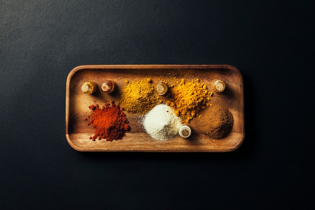 Indian spices on wooden board