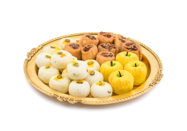 Indian spicy bhakarwadi with apple shaped peda or white peda