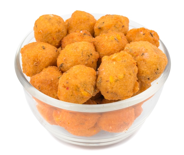 Indian spicy street food dal vada on white background