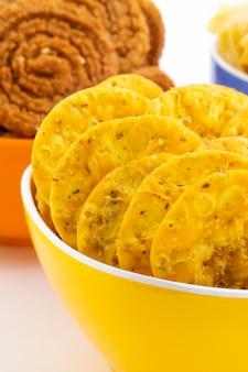 Indian street snack masala khari papdi with besan papri or chakli