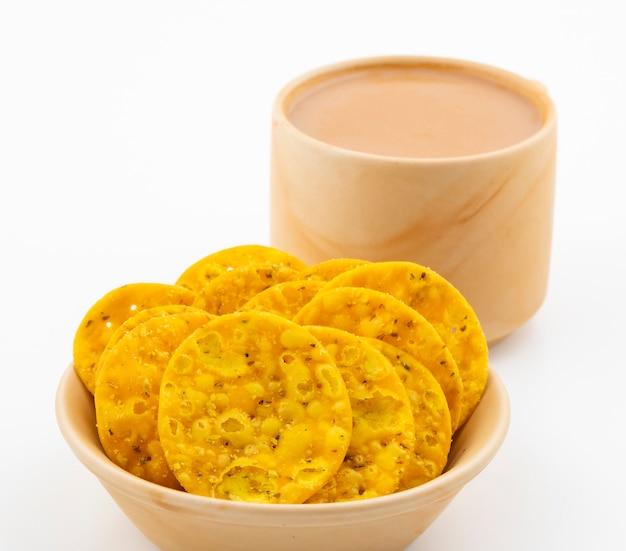Indian street snack masala khari with tea on white