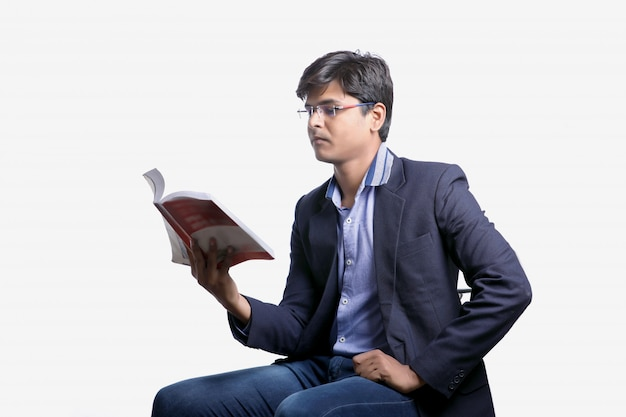 Indian student reading book