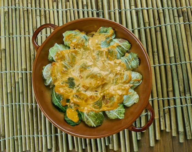 Indian stuffed  curry cabbage  with brown rice and vegetables - bandh gobi ki rolls