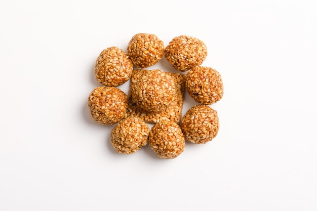 Indian sweet dish,sesame seeds ball or called in hindi, til ke laddu on white background
