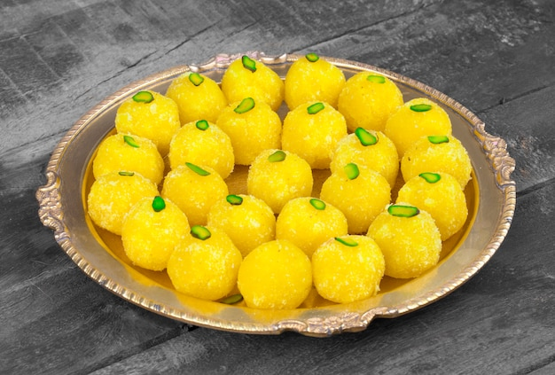 Indian sweet food coconut laddu on wooden background