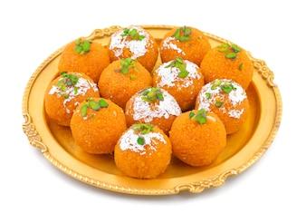 Indian Sweet Food Motichoor laddu or Bundi Laddu Isolated on White Background