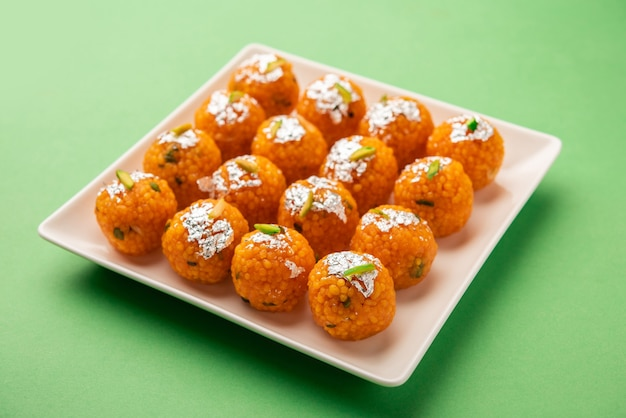 Indian sweet motichoor laddooã'âor bundi laddu made of gram flour very small balls or boondis which are deep fried and soaked in sugar syrup before making balls