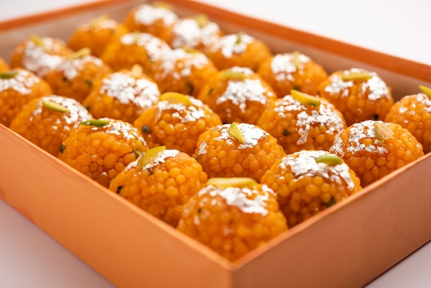 Indian sweet motichoor laddooâor bundi laddu made of gram flour very small balls or boondis which are deep fried and soaked in sugar syrup before making balls